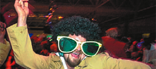 Man dancing with green glasses Disco style